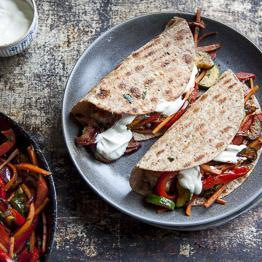 Pic of Beef and veg fajitas with re-fried beans and soured cream