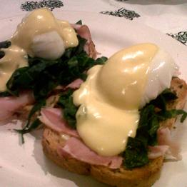 Pic of Eggs Benedict with purple sprouting broccoli or spring greens
