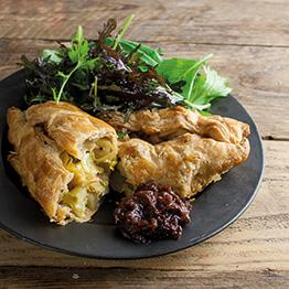 Pic of Leek and smoked cheddar pasties with dressed salad leaves and chutney