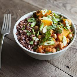 Pic of Squash and chickpea chilli bowl with red rice and shredded spring onions