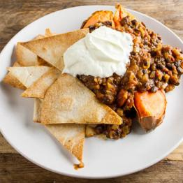 Pic of Sweet potato jacket and black bean chilli with soured cream and homemade tortilla chips